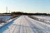 image of snowy-road  - country snowy road in winter rural area - JPG