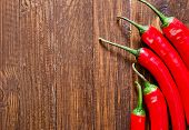 image of red hot chilli peppers  - red hot chilli peppers on the wooden table - JPG