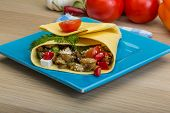 image of pita  - Pita with roasted aubergine in board on wooden background  - JPG