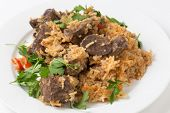 picture of liver fry  - lightly fried lambs liver chunks baked on top of a pilaf of rice - JPG