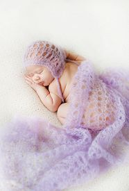 picture of pale skin  - Cute newborn baby peacefully sleeping on the white bed - JPG