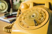 foto of rotary dial telephone  - Old style rotary of a phone numbers - JPG