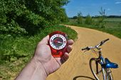 stock photo of compasses  - The compass and the bike - JPG