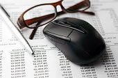 stock photo of field mouse  - Close up of Accounting report with narrow depth of field  - JPG
