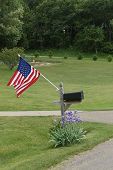 stock photo of mailbox  - In rural Ohio this flag is attached to the mailbox as a symbol American Patriotism - JPG