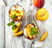 picture of iced-tea  - Glasses Of Peach Iced Tea on wooden table - JPG