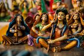 stock photo of rajasthani  - Beautiful clay dolls of miniature musicians performing in a band of classical music