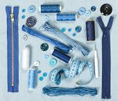 picture of zipper  - Sewing accessories on blue denim background - JPG