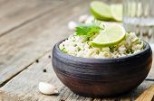 pic of cilantro  - cilantro lime garlic brown rice on wooden background - JPG