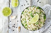 picture of cilantro  - cilantro lime garlic brown rice on wooden background - JPG