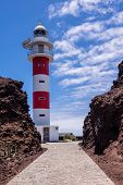 pic of faro  - Lighthouse Faro de Punta de Teno on shore of the Atlantic Ocean on the island Tenerife.