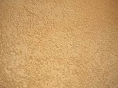 stock photo of fragmentation  - Fragment of the yellow wall surface of the cement - JPG