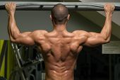 foto of pull up  - Young Male Athlete Doing Pull Ups  - JPG