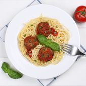 stock photo of meatball  - Italian cuisine spaghetti with meatballs noodles pasta meal from above on a plate - JPG