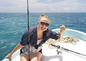 image of catch fish  - Woman proudly displays her deep sea fish catch - JPG