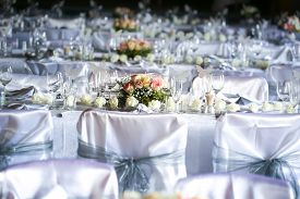 stock photo of funeral  - Laid table at a wedding funeral reception - JPG
