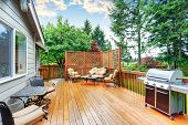 Spacious Wooden Deck With Patio Area And Attached Pergola. poster