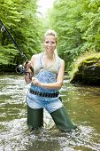 pic of fisherwomen  - woman fishing in river in summer country - JPG