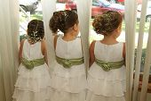 picture of flower girl  - Three flower girls anxiously waiting for the limo - JPG