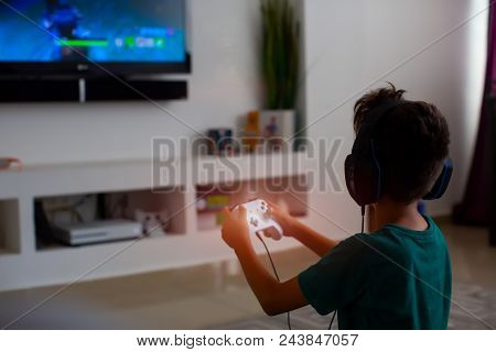 poster of Back View Of Concentrated Young Gamer Playing Game. Gaming Game Play Tv Fun Gamer Gamepad Guy Contro