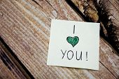 I Love You Emotional Handwritten Message Written On The White Paper With Retro Wooden Bark Backgroun poster