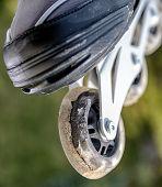 Damaged Inline Wheels. Damaged Skates. Close Up View poster