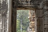Stone Carved Face Of Ancient Buddhist Temple Bayon In Angkor Wat Complex, Cambodia. Ancient Architec poster