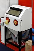 pic of sandblasting  - Sand blasting cabinet in metal work shop - JPG