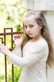 Girl With Long Hair On Calm Face, Urban Background. Kid Girl Long Hair Looks Cute And Tender, Close  poster
