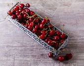 Ripe Cherry On The Table. Ripe Cherries In A Metal Basket. Delicious Berries. Summer Delicious. The  poster