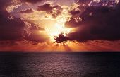 Thundering Sunset On The Ocean: Powerful Dark Storm Clouds In The Sky, The Sun Makes Its Way Through poster