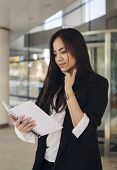 Beautiful Hispanic Business Woman Reading Something  In A Copy Book, Thinking, Office Worker poster