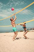 Beach Games. Beach Volleyball Concept. Couple Have Fun Playing Volleyball. Young Sporty Active Coupl poster