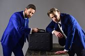 Businessmen With Black Briefcase On Dark Background. Men In Suit Or Business Partners With Serious F poster