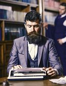 Writer At Work. Man With Beard And Busy Face Sit In Library And Work With Typewriter, Close Up. Writ poster