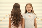 Best Hairstyles For Long Hair. Cute Small Girls With Long Brunette And Blond Curls In Playroom. Ador poster