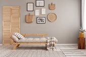 Stylish Vintage Armchair In Contemporary Living Room Interior With Futon Settee And Wooden Scandinav poster