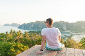 Young Man Sitting And Enjoying Freedom On The Top View Mountains On A Sunny Day. Portrait Of Male En poster