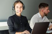 Portrait Of Woman Customer Service Worker, Call Center Smiling Operator With Phone On Office poster