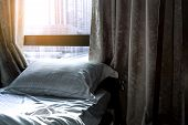 White Comfort Bed And Soft Pillow In Modern Bedroom. Bed Near Window And Curtain At Hotel In The Mor poster