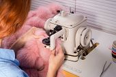 Professional Master In The Manufacture Of Clothing From Fur. Woman Couturier At The Sewing Machine,  poster