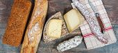 Cheeses, Sausage And Tomme De Savoie, French Cheese Savoy, French Alps France. poster