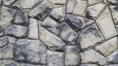 The Texture Of The Stone Wall. Old Castle Stone Wall Texture Background. Stone Wall As A Background  poster