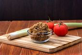 Domestic Salty Fried Pork Greaves, Duvan Cvarci, In A Glass Bowl With Tomato And Leek On A Cutting B poster
