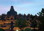 stock photo of arjuna  - Borobudur Temple at Dusk in Yogyakarta - JPG