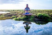 Young Woman, Meditating, Practicing Yoga And Pranayama At The Beach. Sunrise Yoga Practice. Hands In poster
