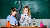 Biology Experiments With Microscope. Little Kids Scientist Earning Chemistry In School Lab. Chemistr poster