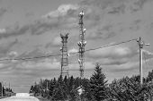 A Wide Monochrome View Of Service Provider Infrastructure In A Canadian Town. With Cell Site Tower,  poster