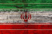 National Flag  Of Iran On A Wooden Wall Background. The Concept Of National Pride And A Symbol Of Th poster