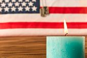 American Flag And Army Tokens  And Memorial Candle On Memorial Day  . On Wooden Table. Selective Foc poster